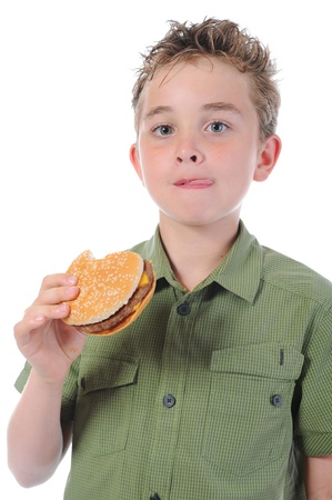 Little boy eating a hamburger Stock Photo - 9952232
