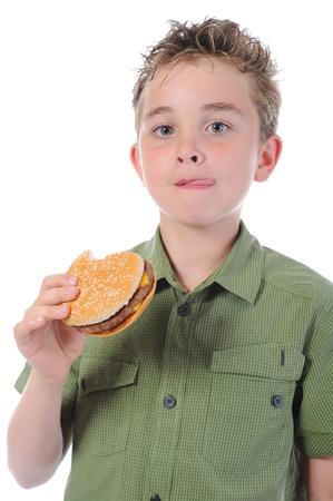 Little boy eating a hamburger photo