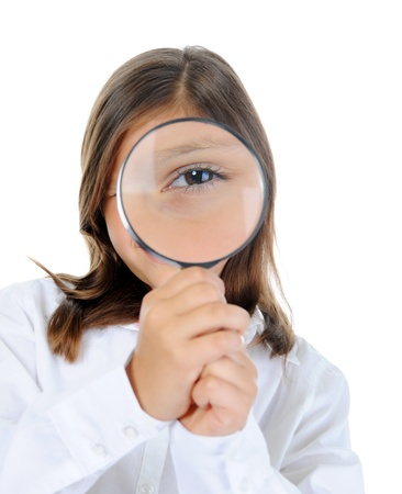 girl looking through a magnifying glass photo