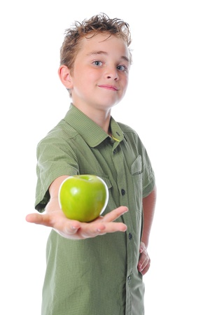 Boy holding an apple photo