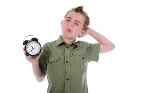Sleepy boy with alarm-clock Stock Photo - 9952028