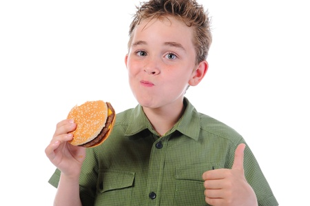 Little boy eating a hamburger Stock Photo - 9952241