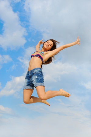 Beautiful Woman over blue Sky Stock Photo - 9952247