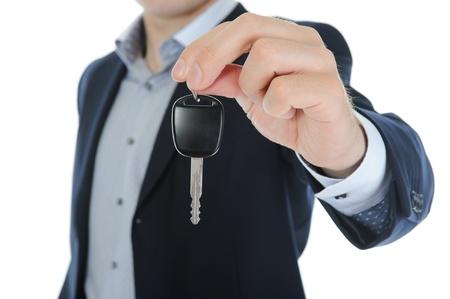 d?a: Empresario da las claves para el coche Foto de archivo