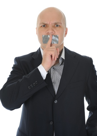 young businessman holding a finger to his mouth. photo