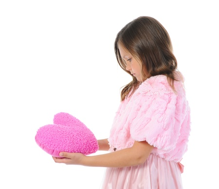 Little girl holding heart photo