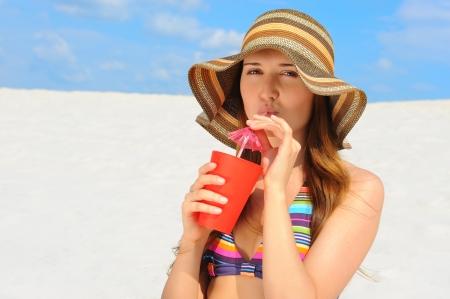 beach drink: beautiful woman on the beach