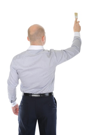 businessman with a brush in his hand photo