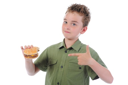 Little boy eating a hamburger Stock Photo - 9952395