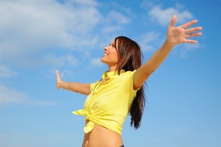 Beautiful Woman over blue Sky Stock Photo - 9952298