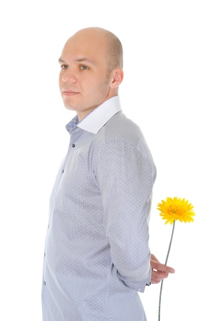man holding a red flower photo