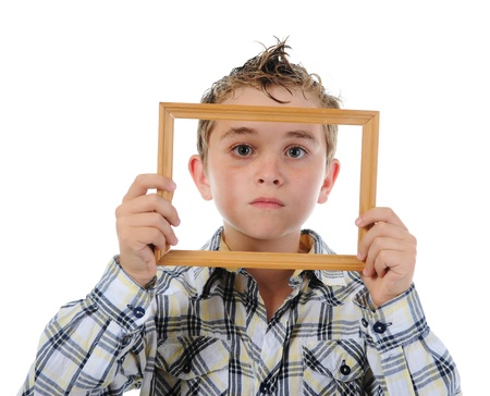 little boy with a frame in his hands photo