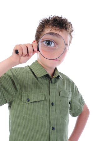boy looking through a magnifying glass Stock Photo - 9952458
