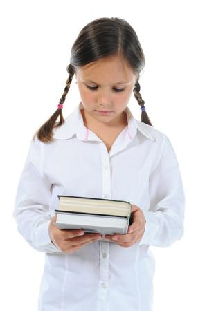 Little girl  holding her book Stock Photo - 9952328
