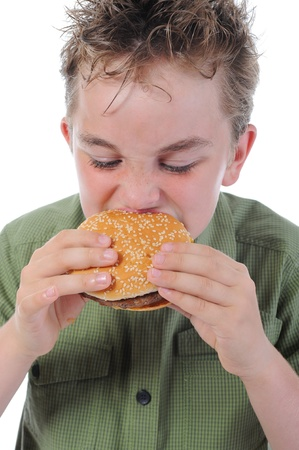 Little boy eating a hamburger Stock Photo - 9952415
