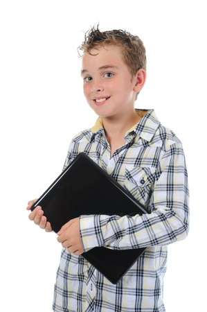 Happy little boy with laptop. photo