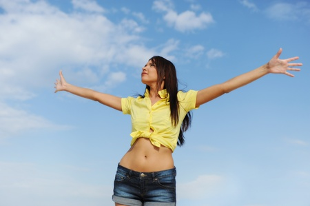 Beautiful Woman over blue Sky Stock Photo - 9952173