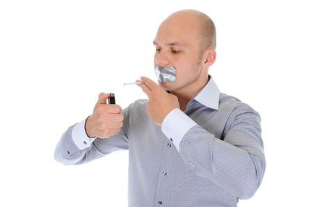Businessman holding a cigarette photo