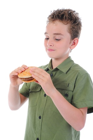 Little boy eating a hamburger photo