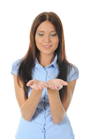 woman looks at her open palm. photo