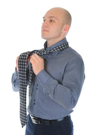 Businessman tying his tie Stock Photo - 9952193