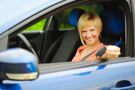 smiling young woman in the car Stock Photo - 10477427