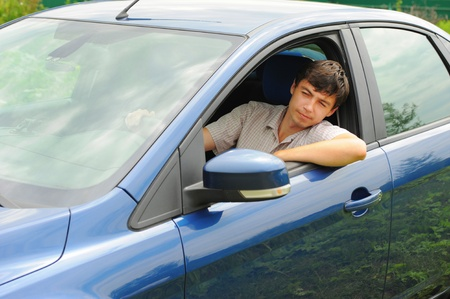 smiling young man in the car Stock Photo - 10477432
