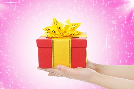 gift in the hands of women Stock Photo - 10498419
