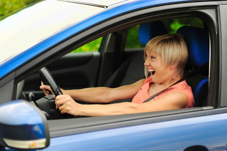 smiling young woman in the car Stock Photo - 10498423