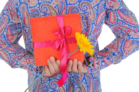 man with a gift box and a flower Stock Photo - 10544800