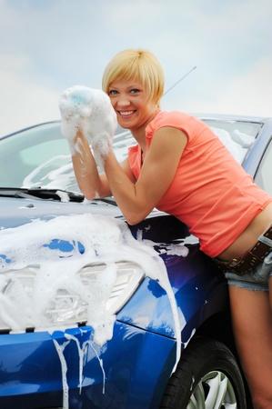 car clean: woman washes her car
