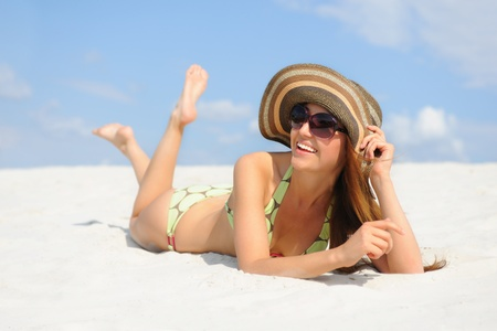 beautiful woman on the beach photo