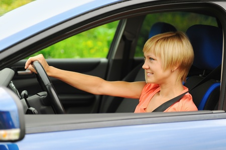 smiling young woman in the car Stock Photo - 10620516