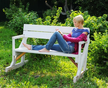 woman reading book in park Stock Photo - 10620569