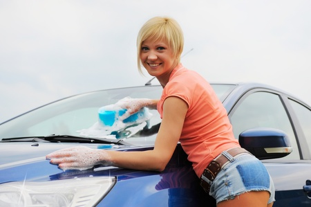 car cleaning: woman washes her car