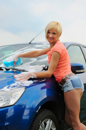 woman washes her car Stock Photo - 10657038