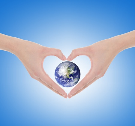 love of planet: Hand make a heart Stock Photo
