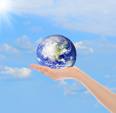 environmental safety: Planet Earth in the female hand