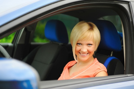 smiling young woman in the car photo
