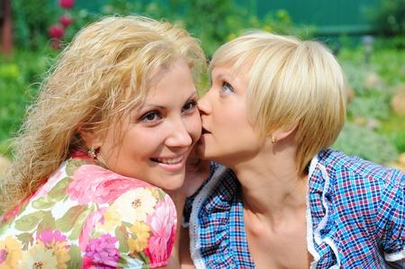 girlfriends talking, gossips in secret photo