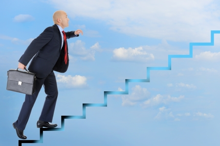 Businessman runs up the career ladder photo