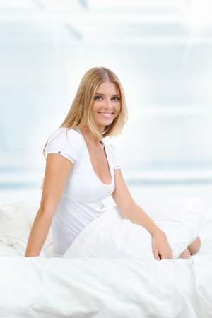 woman on the bed photo