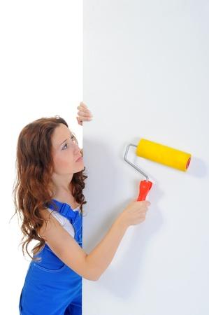 Beautiful young woman doing repairs Stock Photo - 11107778