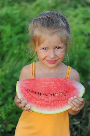 Young girl eating watermelon Stock Photo - 11107824