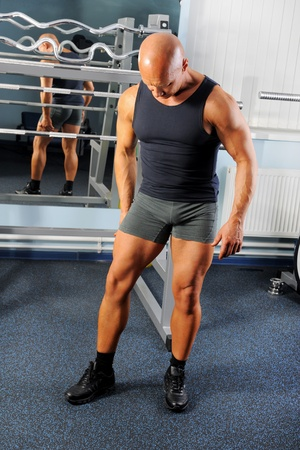 bodybuilder showing his muscles photo