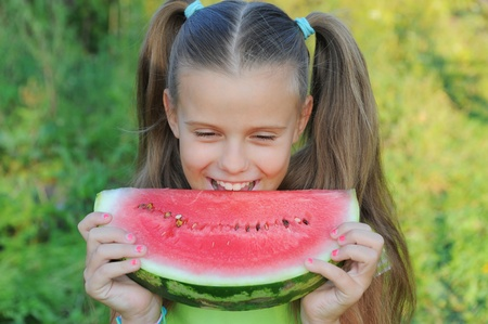 Young girl eating watermelon Stock Photo - 11107941