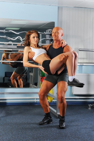 man legs: man and a woman in the gym Stock Photo