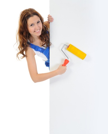 white color worker: Beautiful young woman doing repairs