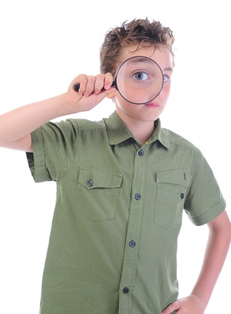 boy looking through a magnifying glass isolated on a white background photo