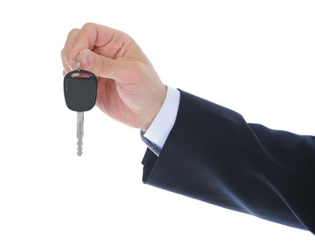 Businessman gives the keys to the car photo